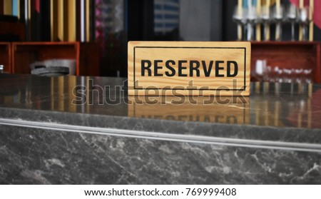Reserved sign on a table.