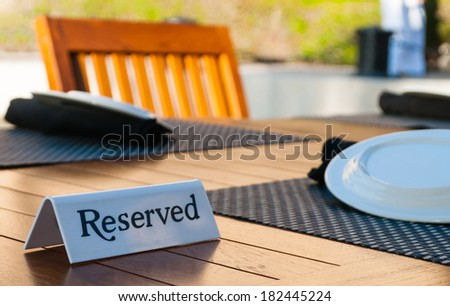 Reserved sign on a table in restaurant - selective focus - stock photo