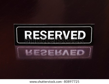 Reserved sign on the table - stock photo