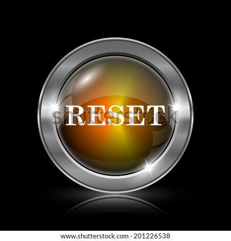 Reset icon. Metallic internet button on black background.  - stock photo