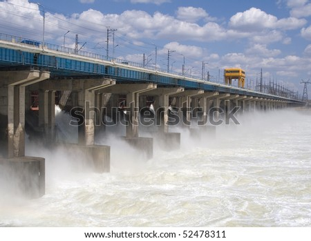 Reset of water at hydroelectric power station on the river - stock photo