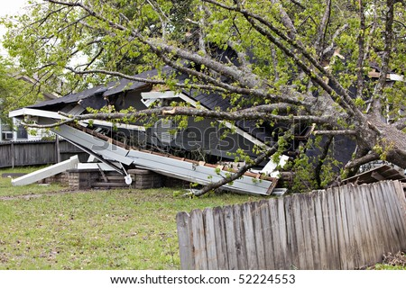Residences a week after being struck by a tornado.  Some clean up has been completed. - stock photo