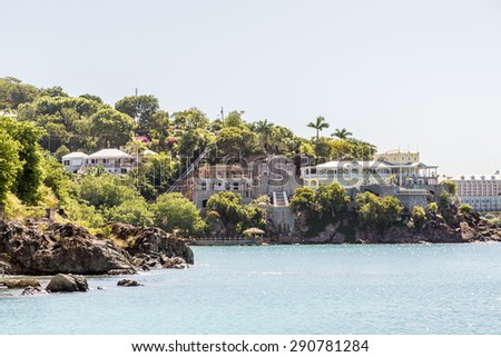 Residential and resort construction on the rocky coast of St Thomas - stock photo