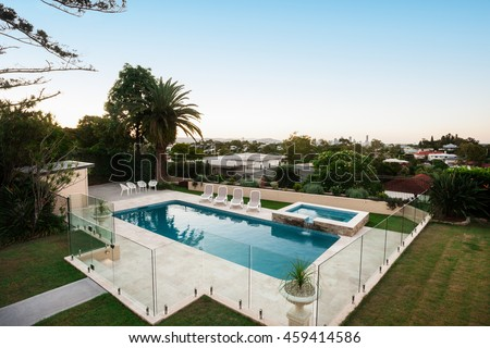 Residential Area View Among The Trees With A Luxury Swimming Pool Covered Glass Of