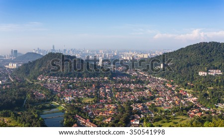 Residential area with Kuala Lumpur City in the background.