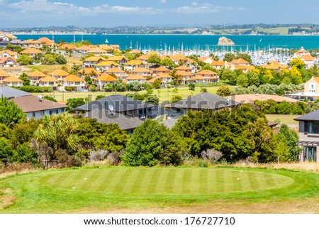 Residential area with marina on a background and a golf course on a foreground - stock photo