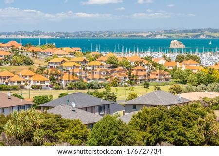 Residential area with marina on a backrgound - stock photo