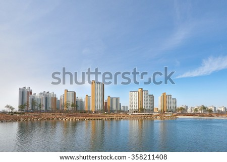 residential buildings and clear lake in a sunny day