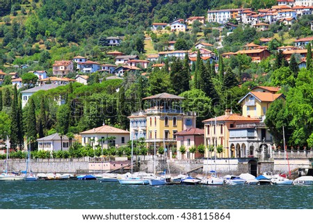 Residential buildings and hotels on the coast of beautiful Como lake, Tremezzo, Italy.