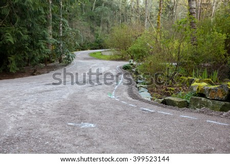 Residential driveway prepared with crushed rock base for paving with asphalt - stock photo