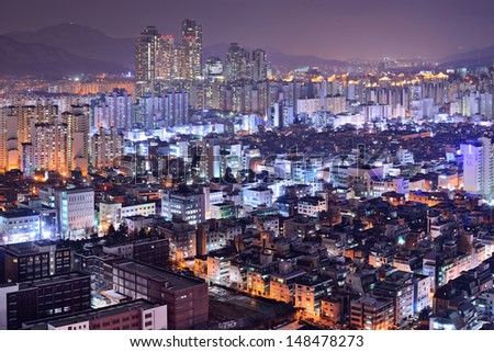 Residential high rises in Gangnam District, Seoul, South Korea skyline at night.