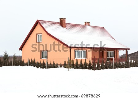 residential house in gray winter day. horizontal shot - stock photo