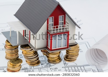 residential house on blueprint, symbolfoto for house construction, financing, building society - stock photo