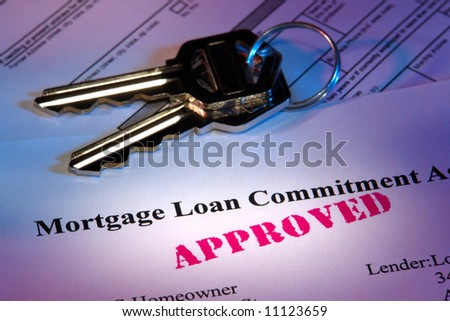 Residential real estate lender home mortgage loan commitment letter with approved stamp imprint and set of house keys
