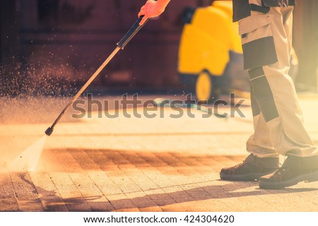 Residential Roadway Brick Cleaning Using High Pressured Water.  - stock photo