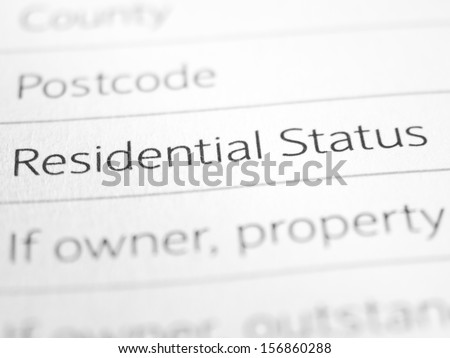RESIDENTIAL STATUS printed on a form close up - stock photo