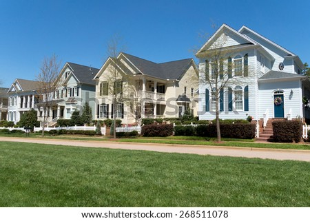 Residential street in spring - stock photo