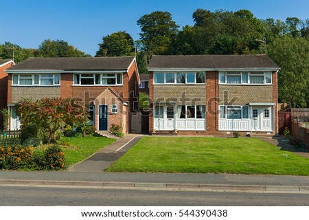 Residential street with a typical contemporary building in England.