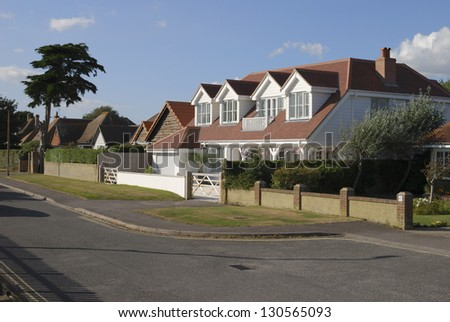 Residential street with detached houses by the beach at Selsey, West Sussex. England