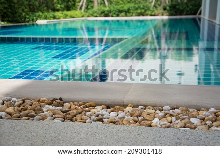 Residential swimming pool in backyard - stock photo