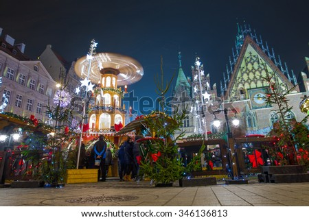 Residents and tourists visit the Christmas market in the Old Market Square in Wroclaw, Poland, EU. A long time shutter exposure.