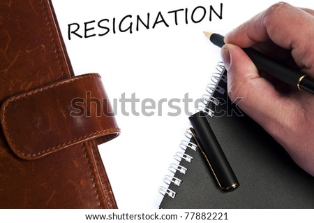 Resignation write by male hand - stock photo