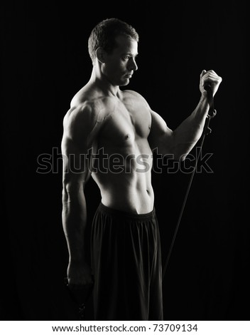 Resistance Bands, low key on black - stock photo