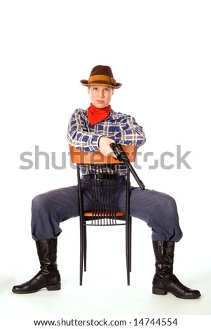 Resolute cowgirl with gun sitting on the chair (isolated on white)