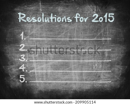 Resolutions for 2015, handwriting on chalkboard  - stock photo