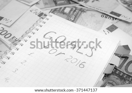 resolutions for new year 2016 with euro bills
