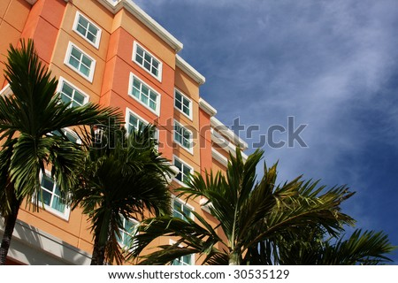 Resort and palm trees - stock photo