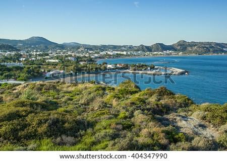 Resort Faliraki, Rhodes Island, Greece. Faliraki is the primary seaside resort village on the Greek island of Rhodes, in the Dodecanese. It is situated on Faliraki Bay, on the northeastern coast - stock photo