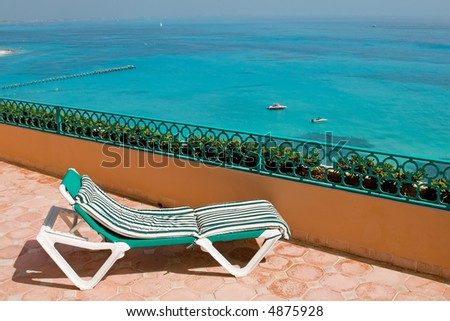 Resort hotel balcony with chaise longues in cancun mexico in the tropics