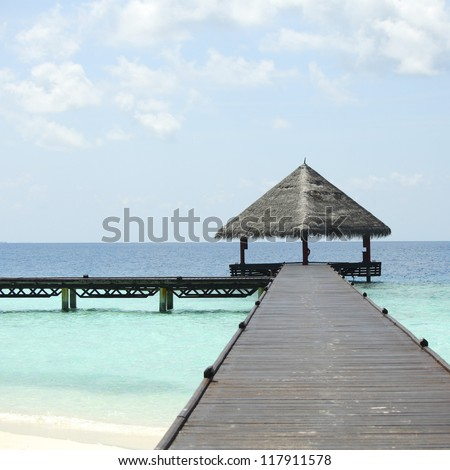resort maldivian houses in blue sea - stock photo