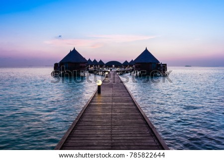 Resort On The Tropical Islands Maldives Bungalows Over Water At Sunset