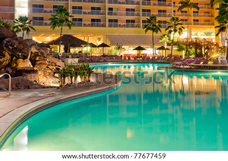 resort with pool at night view