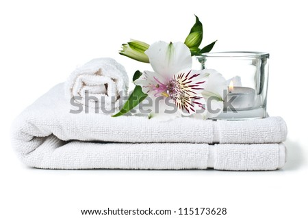 resources for spa, white towel, candle and Alstroemeria flower, isolated - stock photo