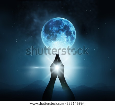 Respect and pray on blue full moon with nature background, Original image from NASA.gov - stock photo