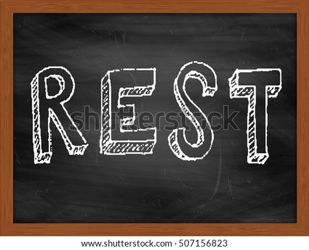 REST hand writing chalk text on black chalkboard