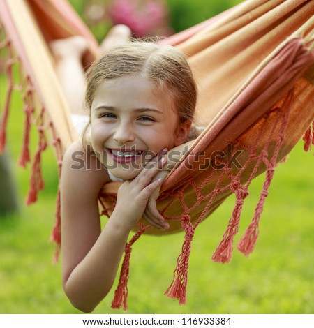 Rest in the garden - lovely girl in hammock - stock photo