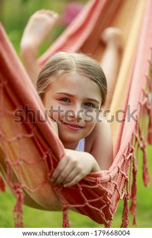 Rest in the garden - lovely girl in hammock - stock photo