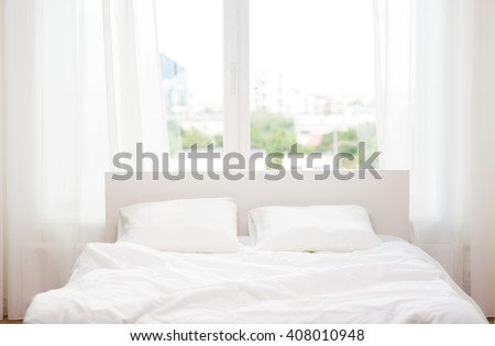 rest, interior, comfort and bedding concept - bed at home bedroom - stock photo