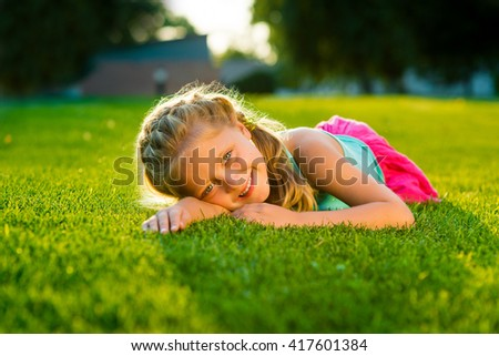 Rest is the best for this little girl whose smile is so beautiful and innocent. Close-up portrait of lovely young princess. Perfect retouching of the shot. - stock photo