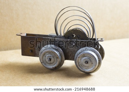Rest of an old clockwork toy locomotive - stock photo