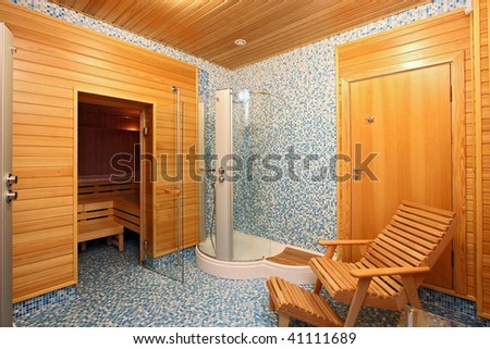 Rest room before a sauna with chaise lounges and per capita cabins - stock photo