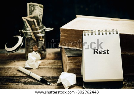 Rest word book on wood table vertical  - stock photo
