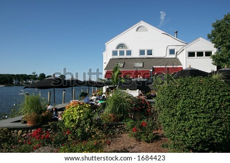 restaurant along river, Mystic, Connecticut - stock photo