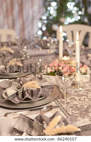 Restaurant christmas table with fancy folded napkins - stock photo