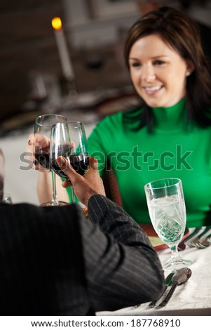Restaurant: Couple Shares Romantic Toast - stock photo