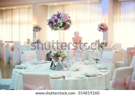 restaurant decorated with pink flower bouquets - stock photo